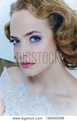 Close-up portrait of a beautiful bride woman. Wedding make-up and hairstyle.