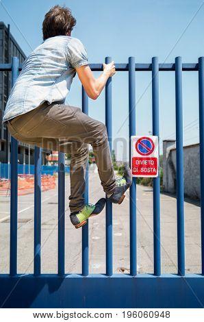 Vandal crossing gate with elegant shoes