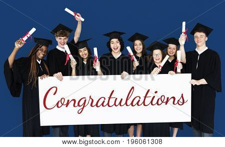Diverse Students wearing Cap and Gown Showing Congratulations Sign Studio Portrait