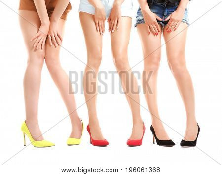 Beautiful female legs isolated on white