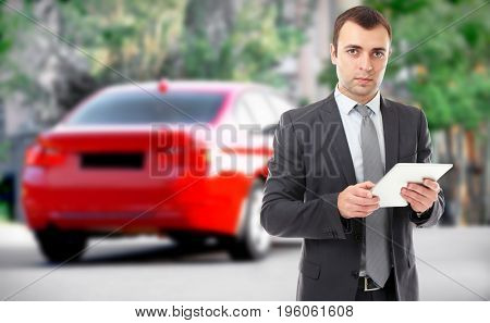 Insurance agent using tablet and car on background