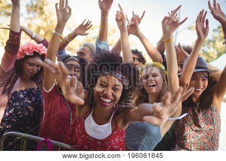 Portrait of cheerful woman enjoying at music festival