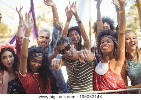 Portrait of cheerful friends enjoying together during music festival