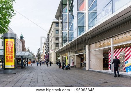 STUTTGART, GERMANY - April 12, 2017 : Tourists foot Street in Stuttgart, its metropolitan area are consistently ranked among the top 20 European metropolitan areas by GDP