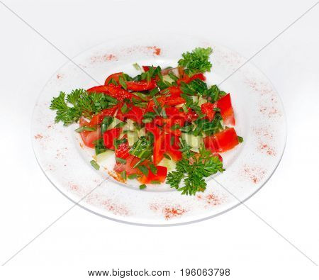 Salad from tomatoes onion and parsley