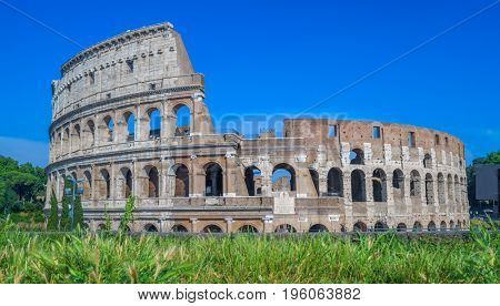 Colosseum ruins on summer sunny day. The main tourist attraction in Rome, Italy.