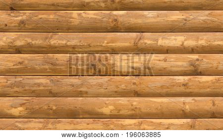 Seamless wooden round timber country house wall texture.