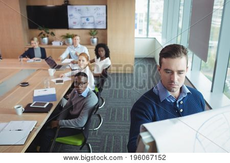 Serious business entrepreneur explaining strategy to team in meeting room at office poster