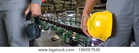 Workers with safety uniform at industrial factory