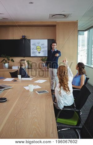 Business people discussing at conference table in board room