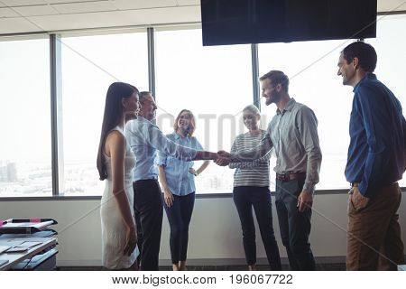 Business people shaking hands at office