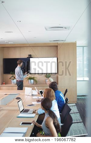 High angle view of business people at conference table during meeting in board room