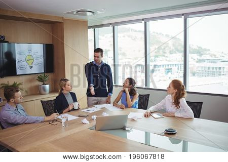 Young business partners discussing in meeting at office board room