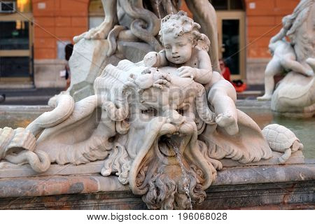 ROME, ITALY - SEPTEMBER 02: Piazza Navona, Fountain figure, sea figure with cherub in the Fountain of Neptune in Rome, Italy on September 02, 2016.
