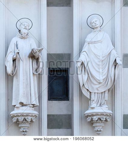 ROME, ITALY - SEPTEMBER 02: Statues of St. Bernard of Clairvaux and Gregory the Great on the facade of Sacro Cuore del Suffragio church in Rome, Italy  on September 02, 2016.
