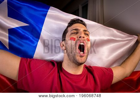 Chilean Guy Celebrating with Chile Flag