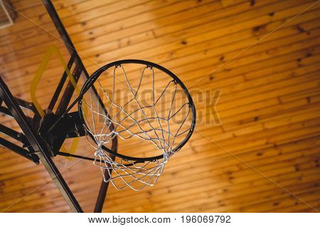 Low angle view of basket ball hoop in court