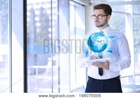 Concept of management information systems. Young man using tablet in office