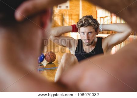 Close up of friends exercising  with hands behind head