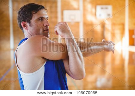 Close up of man looking away while exercising in court