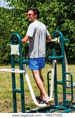 stepper makes fitness exercise outdoor in the park