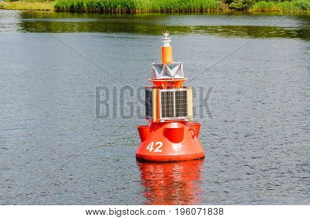 Red Buoy marking the navigational channel in which ships must stay