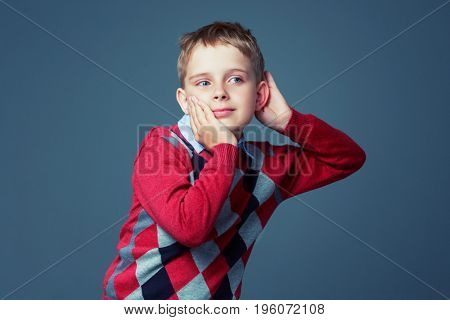 boy listening to something, isolated against grey background