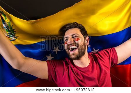 Venezuelan fan holding the national flag