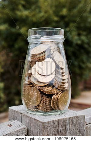 Gold Money In Glass Jar