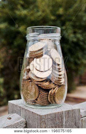 Gold Money In Glass Jar
