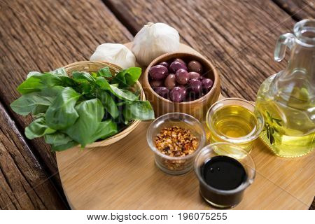 Pickled olives with various ingredients on heart shape board
