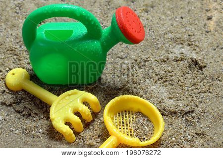 Colorful plastic sand toys on the beach