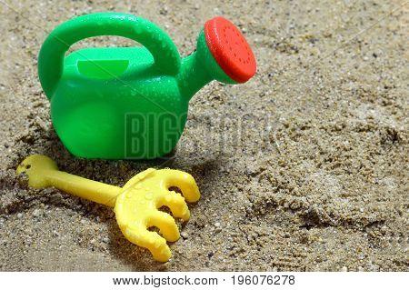 Closeup of plastic sand toys on the beach