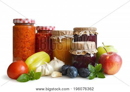 Preserved food in the jars isolated on white background