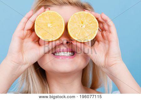 Girl Covering Her Eyes With Lemon Citrus Fruit