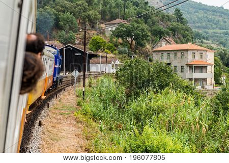 Historic train arriving to Mirao Train Station. The train runs between June and October along the bank of the river Douro.
