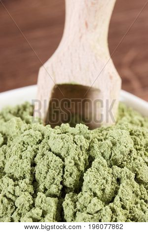 Closeup Of Young Powder Barley With Wooden Scoop, Body Detox Concept
