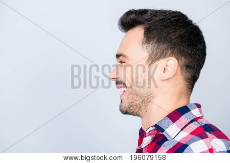 Happy, Joy, Fun, Youth Concept. Side Profile Portrait Of Young Handsome Man In Casual Shirt With Bea