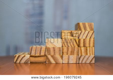 Stairway Of Wood Blocks With Block On Top.