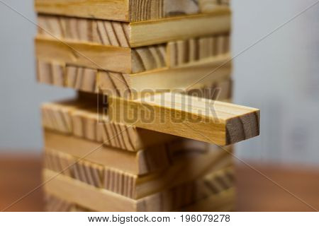 Closeup Take One Block On The Tower From Wooden Blocks,