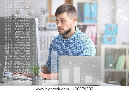 Concept of management information systems. Man working with computer at table in office