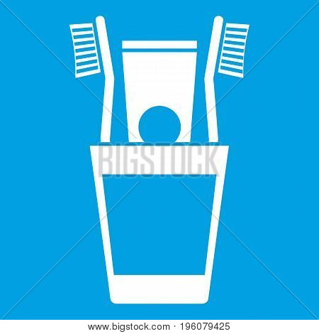 Plastic cup with brushes icon white isolated on blue background vector illustration