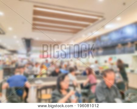 Abstract blurred people in food center