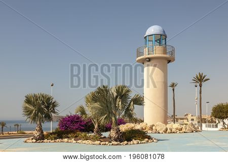 Lighthouse replica in a roundabout in Puerto de Mazarron Province of Murcia southern Spain