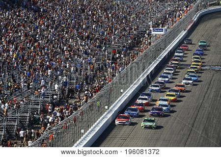 July 16, 2017 - Loudon, NH, USA: The Monster Energy NASCAR Cup Series teams race to turn one during a restart for the Overton's 301 at New Hampshire Motor Speedway in Loudon, NH.