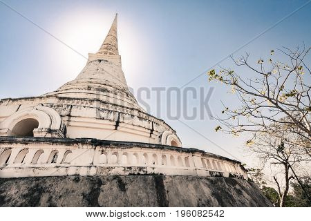 pagoda in sunlight blue sky and frangipani