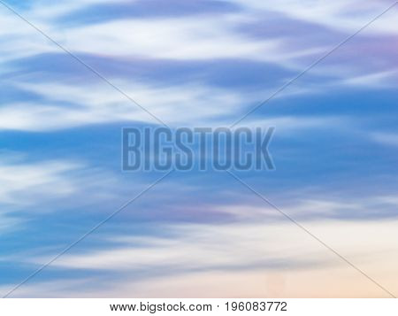 Watercolor effect of a cloudy sky with blue, lavender and yellow tinta
