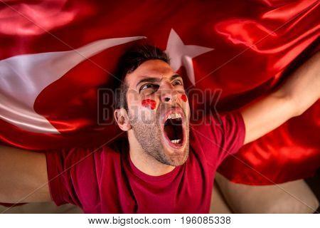 Turkish Guy Celebrating with Turkey Flag
