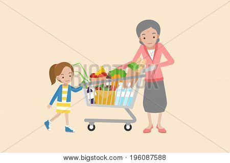 Grand mother holding shopping cart with Grand daughter.