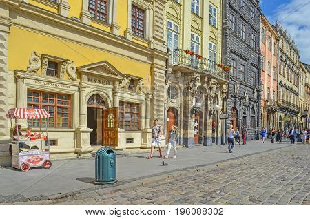Lviv,Ukraine - JULY 14, 2017: Cityscape of Lviv. Medieval architecture of the Central European cities. Old European city Lviv. Cobbled Lviv street with tram tracks